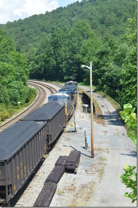 T051-24 has 77 loads which will go to Keyser WV before heading up the old WM to Bayard WV and over the hill to the big power plant. CSX 719-720. Grafton WV.