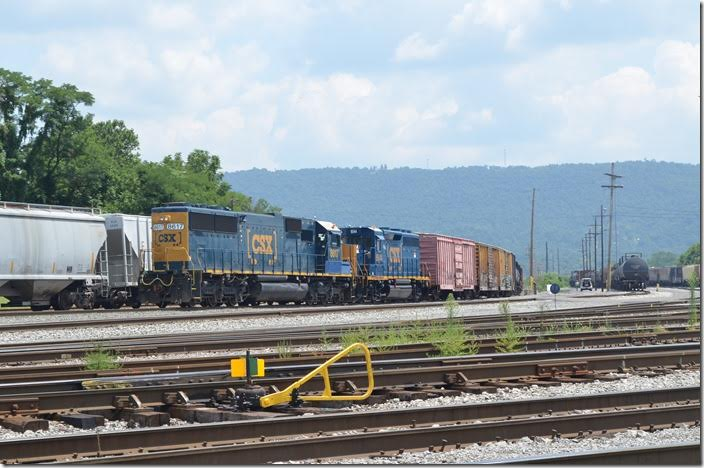 "SD50 8617 and ""GP40-3"" 6544 switch at the west end of the yard. CSX 8617-6544. Cumberland MD."
