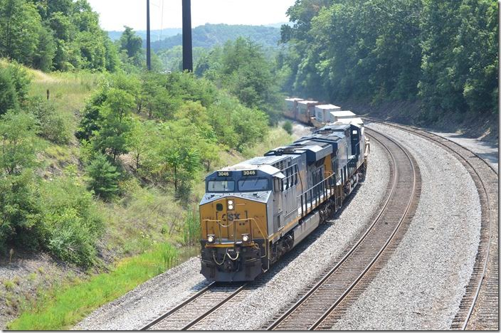 CSX 3046-3143 brakes around the curve with westbound Q135-28 (Portsmouth VA to North Baltimore OH). He has 152 single-stack wells today. Mexico MD.