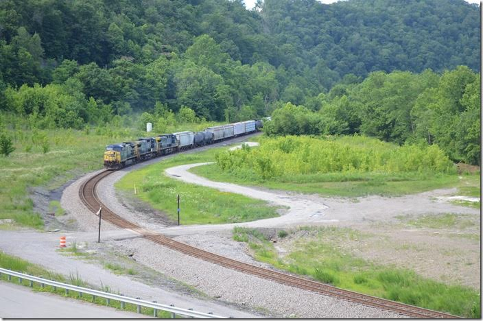 CSX 17-7796-496 head X300, an extra freight, on 06-26-2017. This was great news as these were detour freights and a prelude to resuming regular manifest service on the Big Sandy, Kingsport, and Blue Ridge Subdivisions. Taken at the new bridge to the industrial park very near FO Cabin between Pikeville and Fords Branch. Chaparral Coal's preparation used to cover this vacant lot.