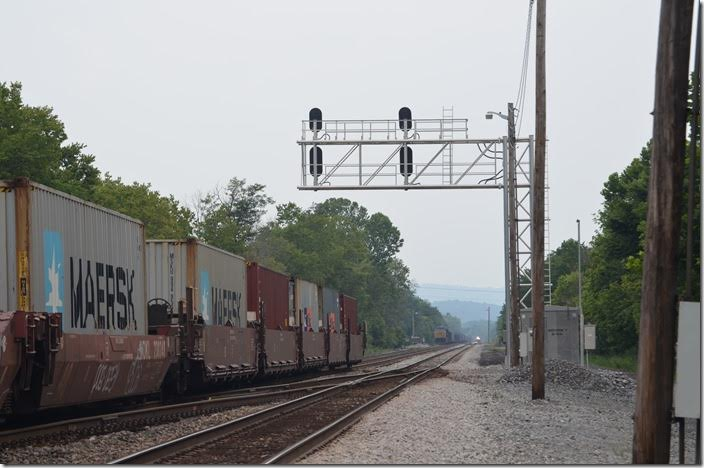 Amtrak's Capitol Limited is fast overtaking Q136 on No. 1 track. That's a dead coal train parked in the east siding. Amtrak 152-822. Green Spring WV.