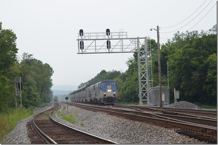 Amtrak No. 30 is due out of Cumberland at 9:20 AM. It is now 11:20 AM at Green Spring (14 miles east of Cumberland), so it is running an hour or so late. P030 has 9 cars. Amtrak 152-822. Green Spring WV.