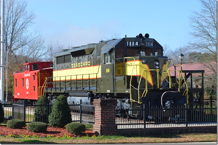 Former SAL SDP35 1114 and a caboose 5241 are on display across the street from the Hamlet Depot & Museum. Hamlet NC.