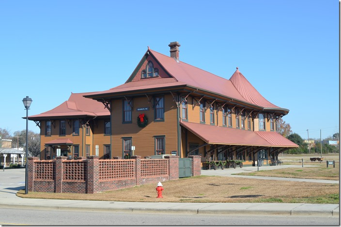 The Hamlet Depot & Museum was moved across the track from the lot in the background.