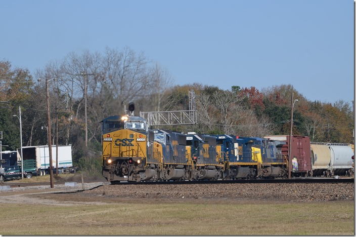 "CSX (Ex-Conrail) 7335 with CSX 8548-8773-8395-7563-553 will head east to Pembroke and then south on the ""A-Line"" to Waycross GA. View 2. Hamlet NC."