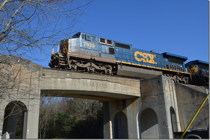 Q471-07 (Rocky Mount-Hamlet) with CSX 7929-7925-7690 is looking at the Bridges Street signal inbound from Pembroke and the Wilmington SD. Hamlet NC.