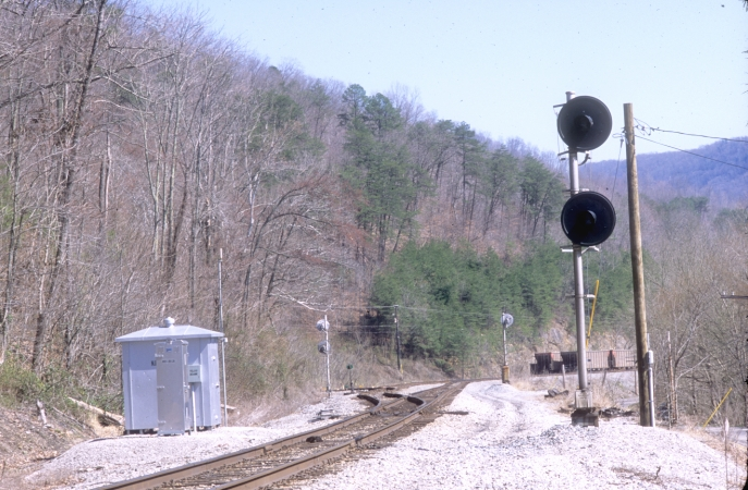 A check of the approach-lit signals at the North End of Pineville revealed nothing.  View is looking south with the passing siding and Wallsend Yard on the left.  A string of ICXX hoppers were stored in the yard. View 2.