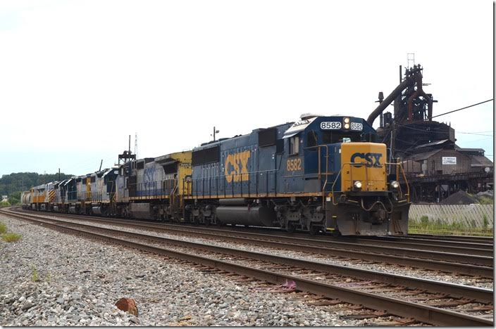 CSX SD50 8582-7778-2508-2317-6158-CREX 1518-1522 with 78 cars of eastbound Q302 roll past AK Steel's idle Amanda blast furnace. CSX lost ore, coke, limestone and slab business; Kentucky Power lost huge revenue. Hopefully it will resume operation, but there are no guarantees. Bellefonte.