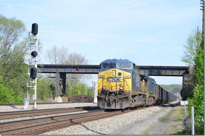 CSX 615-7925 hustles w/b through Kenova under NS at the site of the old union station. 04-18-2015.