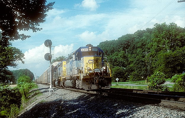 Patch. CSX SD40-2s head southbound multi-level train Q245 (Detroit-Jacksonville) at North Bourne.