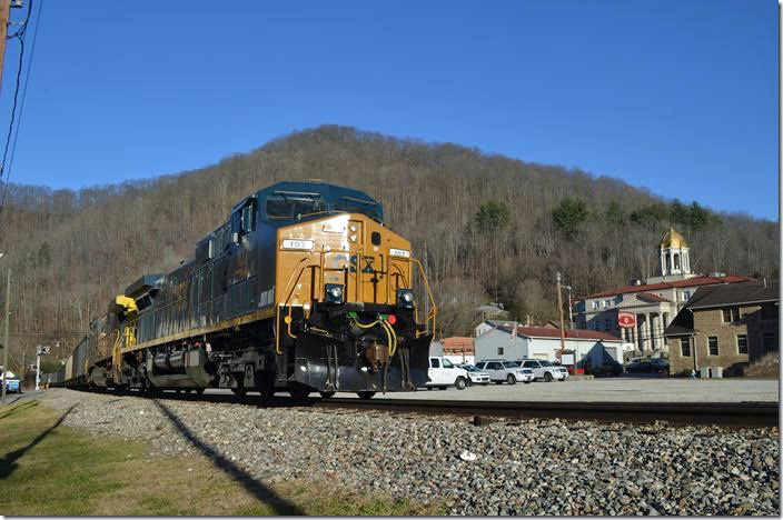 CSX 107-507 pass through Madison WV with the Boone County court house in the background.