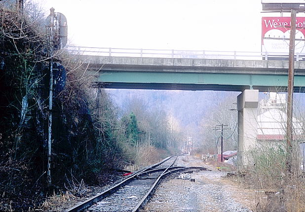 Looking east toward Monitor Jct. That's WV 10 going overhead. The siding once served Logan Concrete.