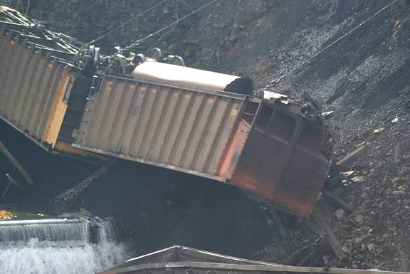 Closeup of one of the derailed cars over the embankment.