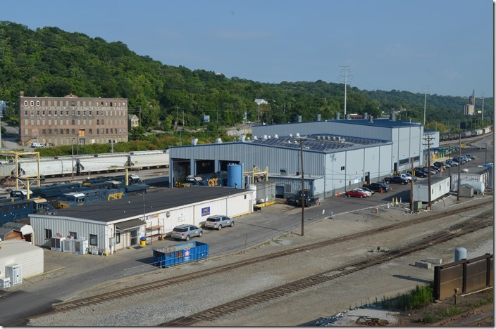 View from administration building (hump yardmaster tower) of the crew building and locomotive shop. CSX crew bldg & shop. Queensgate OH.