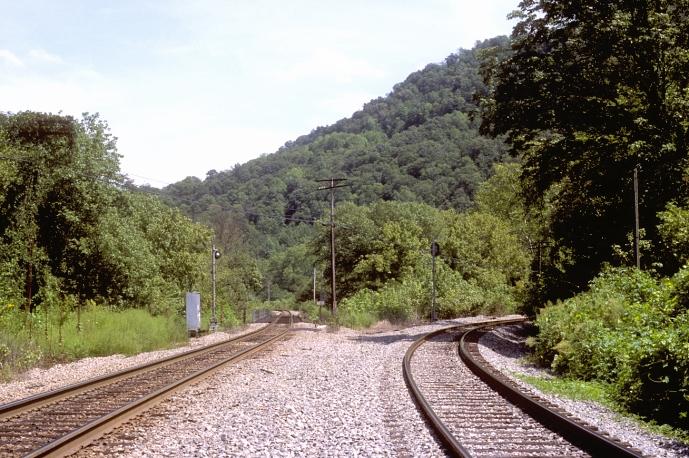Looking south, the Rockhouse Sub. goes straight and across the deck girder bridge over the river. The Whitesburg Branch goes to the right.