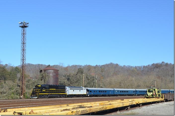 In mid-afternoon the Santa Train rolls into Shelby. That water tank and the flood light towers are the last steam-age structures left in Shelby. CRR 3632-800.