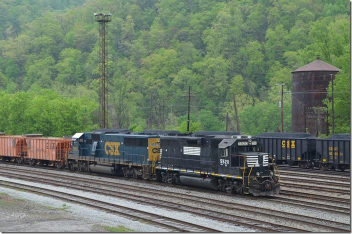 FURX 5520-CSX 8551 on empty ballast train. 04-26-2015. That water tank is the last steam-era structure left at Shelby.