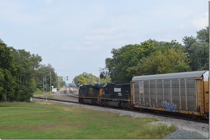 N/b empty multi-level train behind CSX 877-NS 2567 heads up the CE&D.