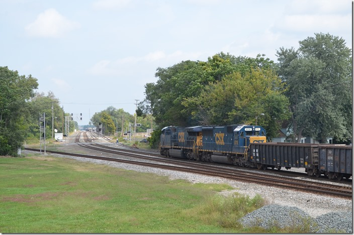 CSX e/b K594 (Rose Lake to Youngstown, OH) empty pipe gons behind 651-8710.