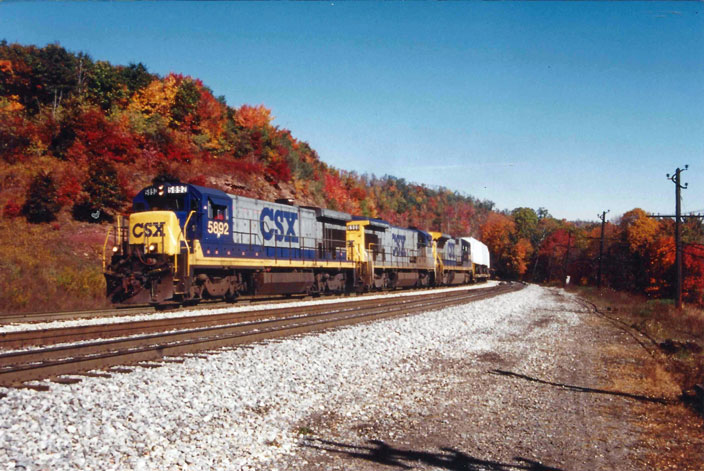 1992. Fall. CSX 5892 in lead. Top of Sand Patch grade.