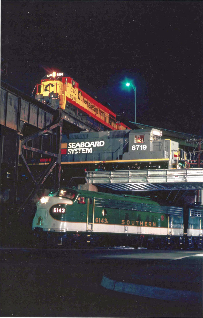 1983. C&O 8295, Seaboard 6719, and Southern 6143. Elevated crossings. Richmond VA.