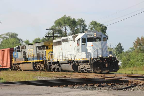 A manifest train headed by GFOX 3076 and CSXT 631.