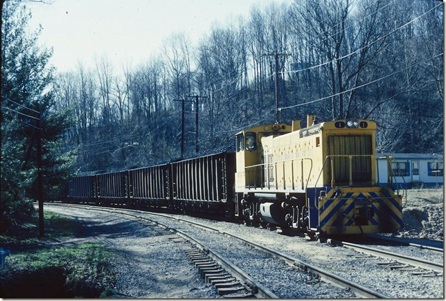 KC&NW 1 shoves loads toward the barge terminal. Cedar Grove WV. 02-20-1990.