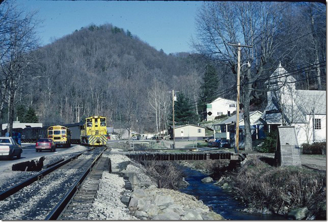 School busses have to wait for trains in Mammoth WV. KC&NW 1. 1990.