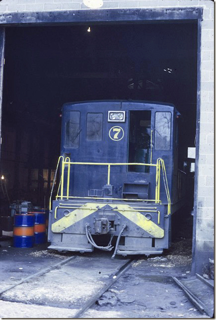 KC&NW no 7 is a 70 tonner in the engine house at Ward WV. 1972.