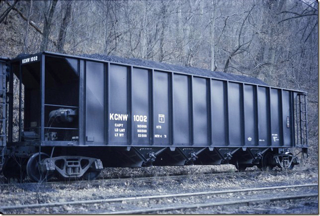 KC&NW hopper 1002 was built by Ortner. Looks like it has friction bearing trucks. 1972.