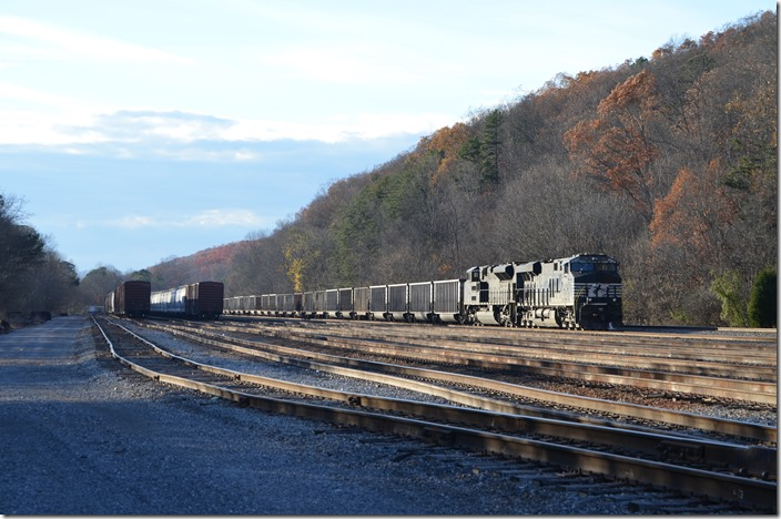 Yuma Yard is in Virginia about three miles west of Frisco. It was used more for coal storage than general freight. 72K-21 pulls to a stop on the passing siding. NS 8079-1039. Yuma VA.
