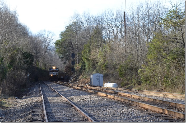 "NS 778-17 approaches the switch to the ""New Connection"" that will lead it back to NS rails. NS 9733-7289-8695. Waycross TN."