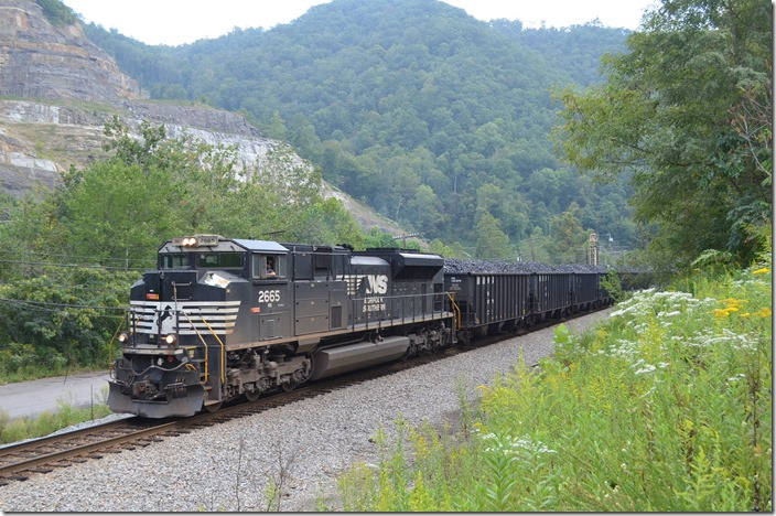 "Shifter U60 has 111 loads of ""Cleveland coke"" from Dismal Yard for Weller. Just above Grundy. NS 2665 near Grundy."