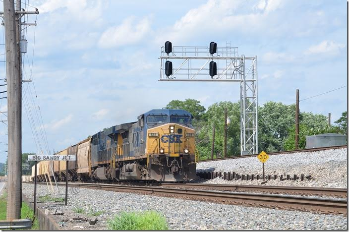 An e/b 60-car grain train rolls off the main line to the Big Sandy SD at Big Sandy Jct. in Catlettsburg. CSX 128-987. BS Jct Catlettsburg KY.