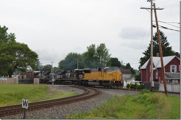 Ex-UP SD90MAC 7312 leads NS 8834-8430 on freight 174-17 (Macon to Elkhart) with 50/108. The southeast connection to the CFE is in the foreground. Bucyrus OH.