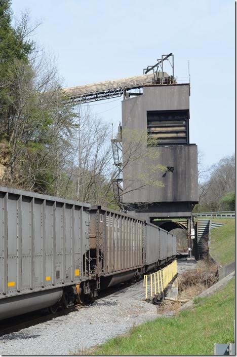 Bell County Coal has NS empty tubs. KY 74 crosses the track ahead of the batch-loader. Bell County uses their ex-C&O GP9 to load the cars. Bell County Coal Hignite tipple Middlesboro KY.