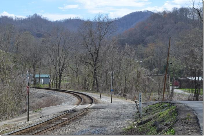 Looking south at CSX MP 232 at Wallins KY. L&N's old Banner Fork Br. once ran through the town in the background to Fordson Coal (Ford Motor Co.) mines on up Wallins Creek. Sue and I found the footers to an old tipple, but there were other mines on the 5-mile branch also. CSX MP 232 Wallins KY