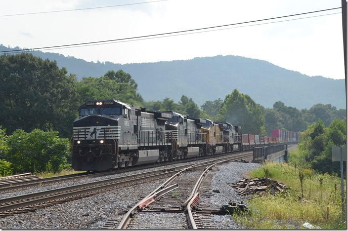 236-21 is crossing US 460 at Villamont. He is really rolling now! The spur goes into a metal recycling business. NS 8902-9255-UP 8904-9015. Villamont VA.