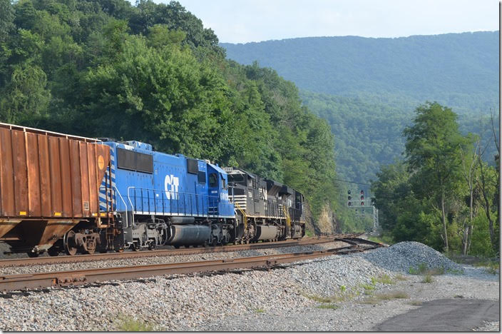 The engineer revealed to the dispatcher that the 6019 had shut down a couple of times, and if it conked out again on the steep grade up to Bluefield they would not make it. The dispatcher said they would have all green signals. NS 8088-7264-CEFX 6019. View 3. Glen Lyn VA.