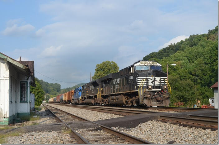 189 is doing OK as it passes the derelict former N&W depot at Oakvale WV. On curvy WV 112 it was challenging to get ahead even though the grade was increasing. NS 8088-7264-CEFX 6019. Oakvale WV.