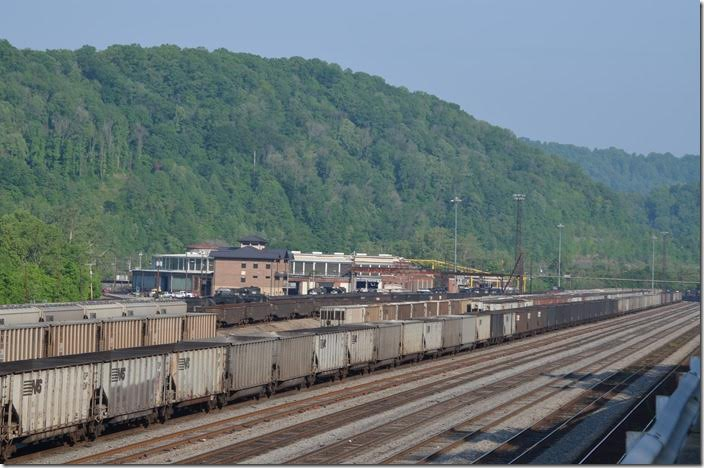 "NS 9308-8368-6628 leads w/b grain train 51Q down through the yard on arrival at Williamson WV. The new yard office is named the ""John W. Fox"" building and is on the left. 05-11-2015."