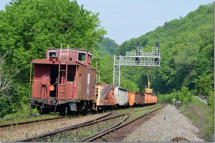 Work train 97J with NS caboose 555585 unloads ties at Naugatuck.