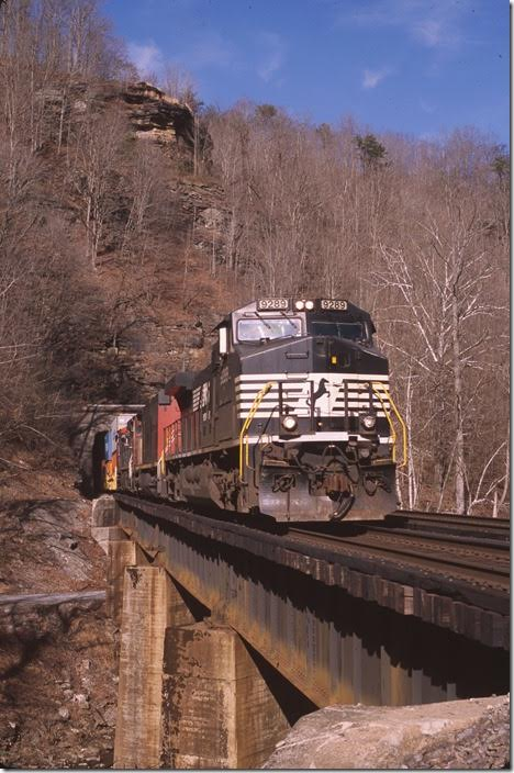 No. 23Q being an intermodal train has gone around 757 at Farm. Exiting Roderfield Tunnel. View 2.
