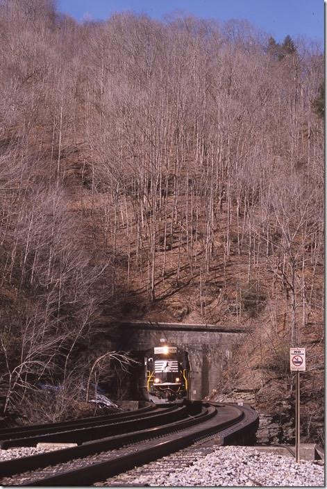 No. 746 exits Gordon Tunnel and crosses US 52 and the Tug Fork at Rogers.
