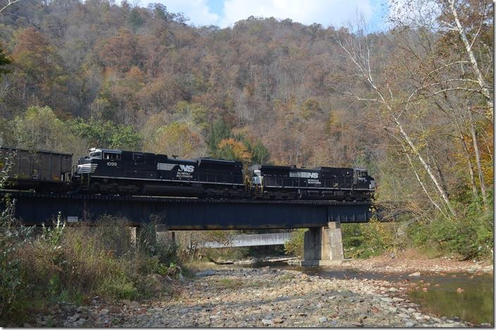 NS 9200-1099 cross Knox Creek near Stopover KY with w/b J42-28 off the Buchanan Branch. This train had 107 loads (Consol Mine at Page VA to Burns Harbor IN) of met coal for Arcelor-Mittal. The crew took it from Weller Yard to Williamson. NS 9200-1099. Stopover KY.