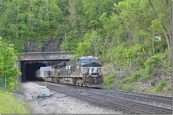 In West Williamson empty e/b coal train 831-06 exits Mingo Tunnel WV behind NS 8162-4074 with 2 loads and 90 empties.
