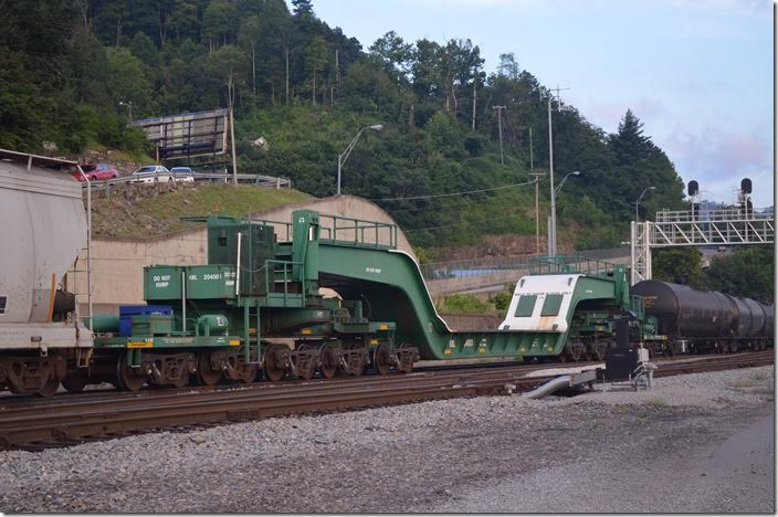 Kasgro Rail Corp. (KRL) 20-wheel depressed flat 204001 has a capacity of 899,500 lbs. It was built in 2008. From their website, KRL has acquired many of these cars from the major railroads. Williamson WV.