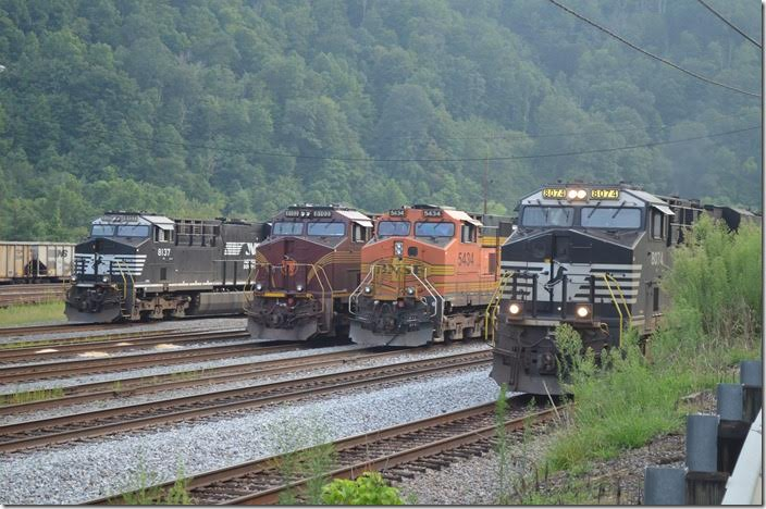 NS 8074-9809-9596 accelerate No. 218-08 e/b (Chicago to Linwood, NC) out of town with 21x5 vans. Williamson WV.