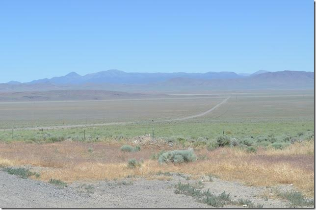 "Looking east at US 50 where it crosses the Big Smoky Valley at the intersection with NV 376. US 50 is called ""America's Loneliest Road"" in Nevada. No argument on that."