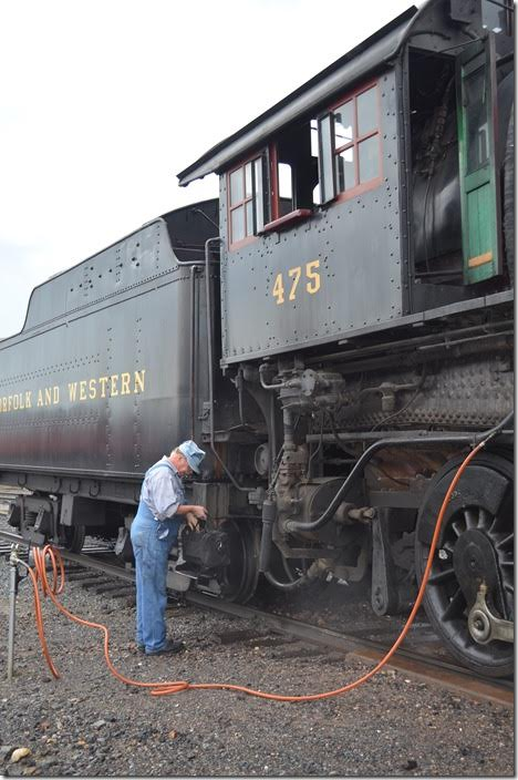 The time honored scene of the engineer with his grip. The engineer and fireman reverse their roles in running the engine.